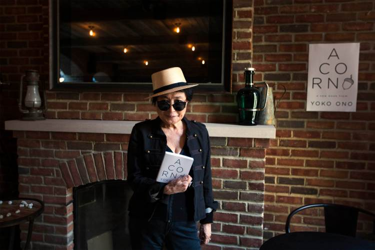 "Yoko Ono poses for a photograph while promoting her new book ""Acorn"" during a book signing in New York"